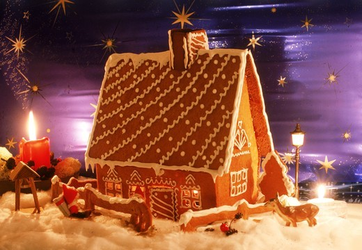 Stock Photo: 4176-27686 Home made gingerbread house with candles during Christmas Season