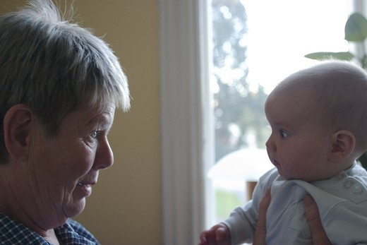 A grandmother meets her grandchild for the first time, Kalmar, Sweden. : Stock Photo