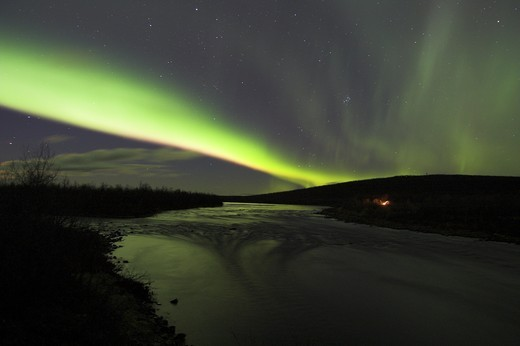 Stock Photo: 4176-29098 Northern lights over open waters in Lainio River.  Lapland. Sweden