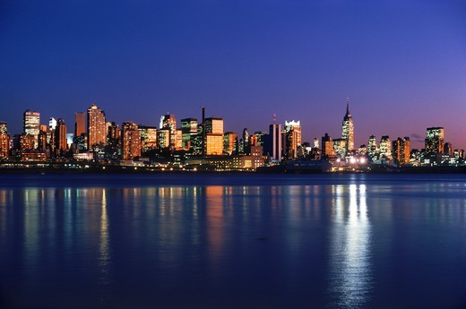 Stock Photo: 4176-30186 New York City skyline with Empire State Building reflecting off Hudson River from New Jersey at dusk
