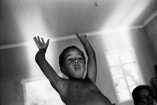 Boy, seven years old holding his arms in the air. Sweden : Stock Photo