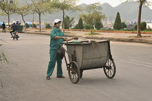Street cleaner in Cat Ba, Halong Bay, Vietnam 2008 : Stock Photo