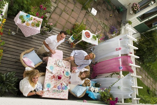 Freinds cheers at a table ready laid gardenparty. Sweden : Stock Photo