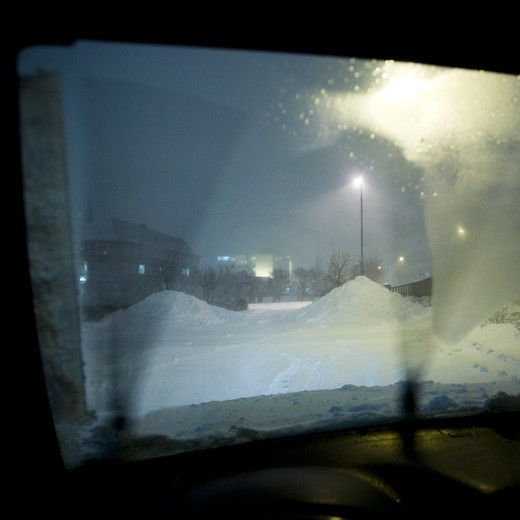 Inside view of a car parked on empty parking lot.  Reykjavik, Iceland. : Stock Photo