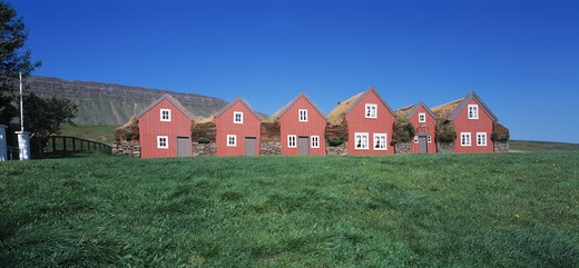 Stock Photo: 4176-37159 Turf houses on a landscape, Burstafell, Iceland