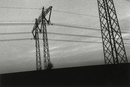 Low angle view of an electric pylon and power lines : Stock Photo