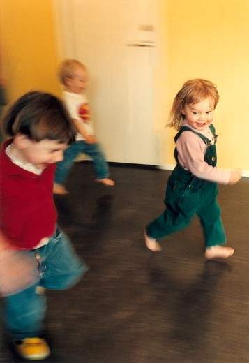 Stock Photo: 4176-4896 Two boys and a girl running. Sweden