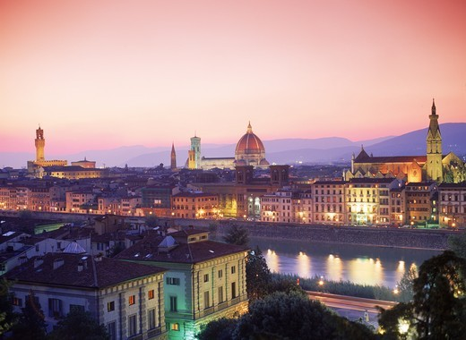 Vecchio Palace left Duomo center and Santa Croce Church right with Arno River in Florence at dusk : Stock Photo