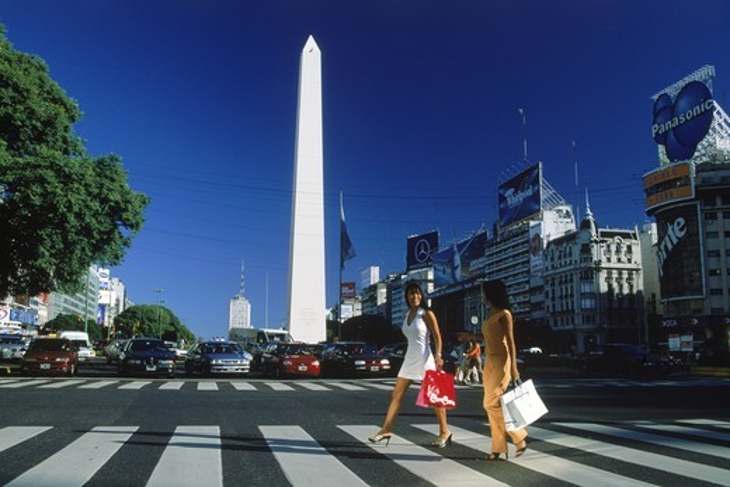 Stock Photo: 4176-5365 Two women with shopping bags crossing Avenida 9 de Julio near Obelisko in Buenos Aires