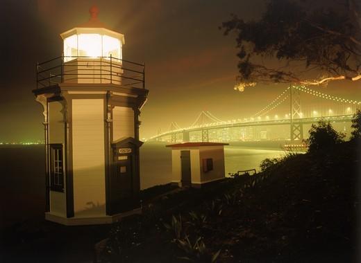 Stock Photo: 4176-5609 Yerba Buena Lighthouse on Yerba Buena Island with Bay Bridge and San Francisco skyline