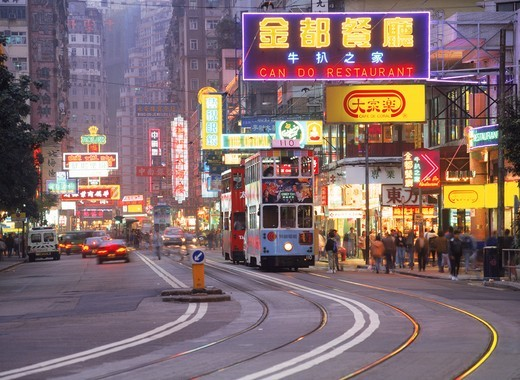Stock Photo: 4176-6066 Trams and neon lights along Hennessy Road at Causeway Bay in Hong Kong