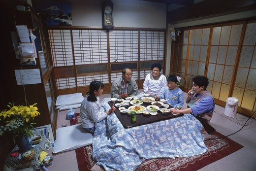 Family eating dinner in main room of  typical Japanese home in Kyoto : Stock Photo