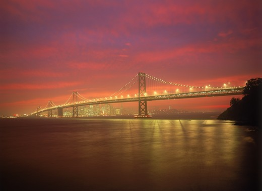 Stock Photo: 4176-6178 Oakland Bay Bridge under colorful sunset skies across San Francisco Bay