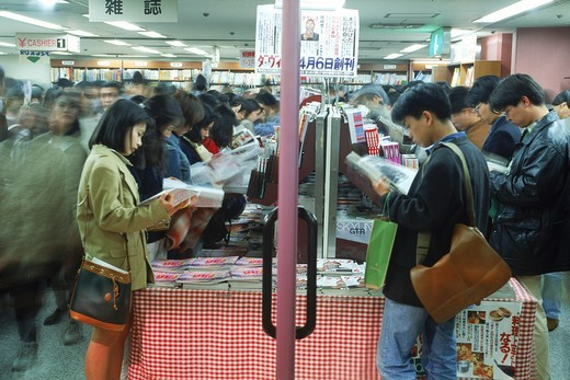 Stock Photo: 4176-6479 People browsing through magazines in Tokyo bookstore
