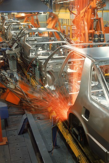 Sparks flying from robatic spot welding at SAAB Scania plant in Sweden : Stock Photo