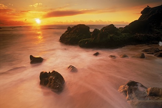 Stock Photo: 4176-6739 Waves painting rocky shore at sunset in Laguna Beach California