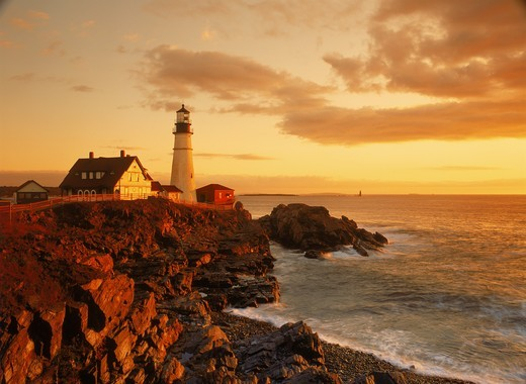 Portland Head Lighthouse at Cape Elizabeth on Atlantic Coast of Maine at sunrise : Stock Photo