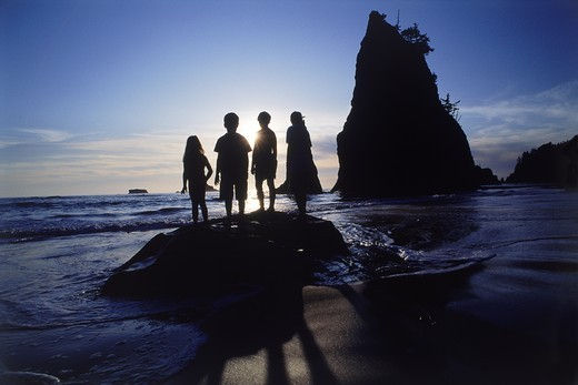 Stock Photo: 4176-6865 Four kids standing on rock at sunset in Olympic National Park
