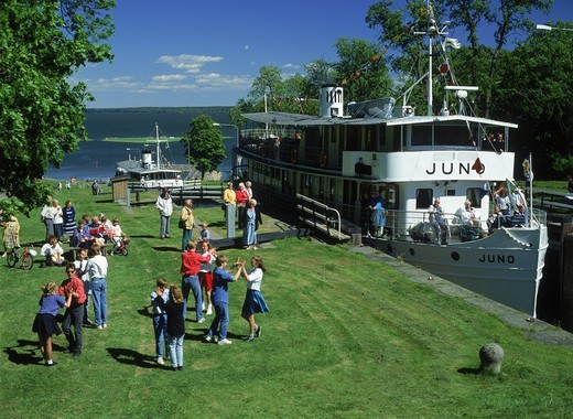 Gota Canal steamer at Berg locks in Sweden with passengers dancing or relaxing : Stock Photo