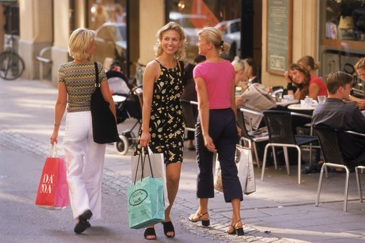 Stock Photo: 4176-7280 Three Swedish women with shopping bags on Stockholm street in summer