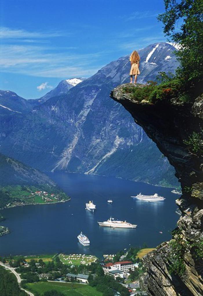Stock Photo: 4176-7305 Norwegian woman on Flydalsjuvet above Geiranger Fjord