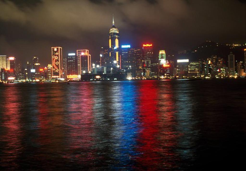 Buildings lit up at night, Hong Kong, China : Stock Photo