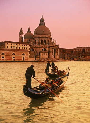 Gondola with Santa Maria dell Salute in Venice at sunset : Stock Photo