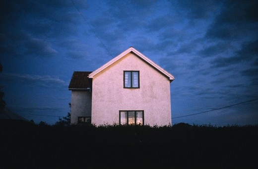 A house illuminated by the setting sun. Sweden : Stock Photo
