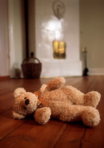 Stock Photo: 4176-8411 Teddy bear on the floor