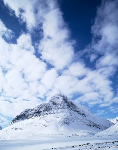 Stock Photo: 4176-9057 Snow covered mountains and cloudy sky
