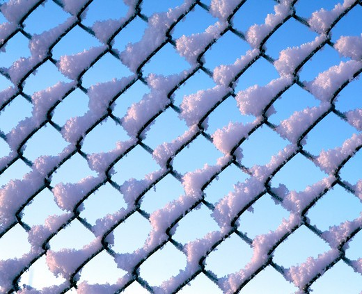 Closeup of net with snow, Sweden. : Stock Photo