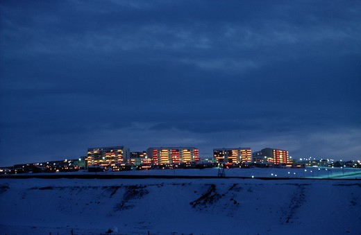 Buildings lit up at dusk, Reykjavik, Iceland : Stock Photo