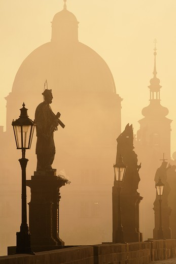 Stock Photo: 4177R-3252 charles bridge prague at dawn during foggy morning