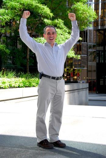 Triumphant businessman : Stock Photo