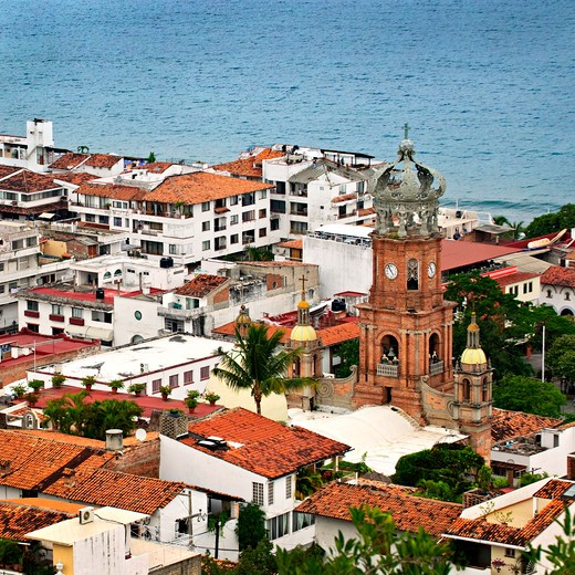 Stock Photo: 4183R-10303 Cityscape view from above with church and Pacific ocean in Puerto Vallarta, Mexico