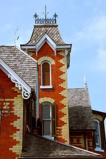 Fragment of a beautiful red brick victorian house : Stock Photo