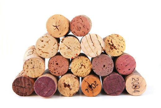Stock Photo: 4183R-10593 A pile of various wine corks on white background
