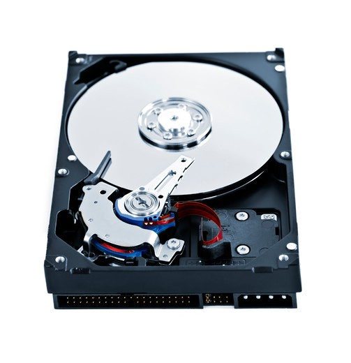 Isolated hard disk drive case showing internal components : Stock Photo