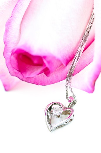 Heart pendant with diamond with a pink rose : Stock Photo