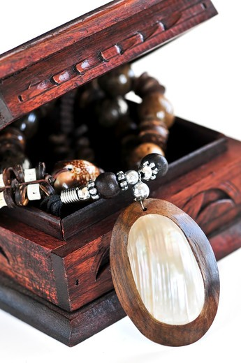 Beautiful handcrafted wooden box with aboriginal jewelry : Stock Photo
