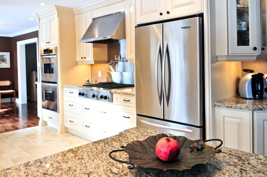 Interior of modern luxury kitchen with stainless steel appliances : Stock Photo