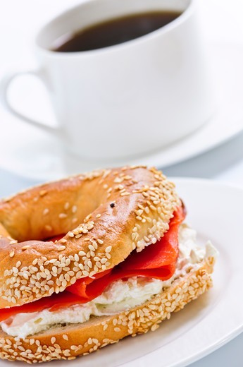 Light meal of smoked salmon bagel and coffee : Stock Photo