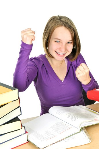 Happy teenage girl studying at the desk : Stock Photo