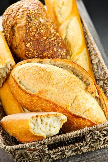 Various kinds of fresh baked bread in basket : Stock Photo