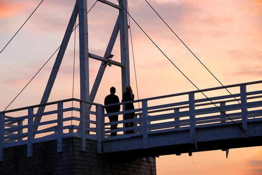 Couple watching sunset on a footbridge in Perkins Cove, Maine : Stock Photo