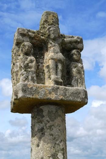 Breton stone cross near Tumulus Saint-Michel church in Carnac, South Brittany, France : Stock Photo