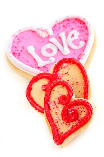 Homemade baked shortbread Valentine cookies with icing on white background : Stock Photo