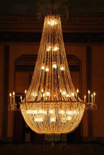 Beautiful chandelier in a hotel lobby : Stock Photo
