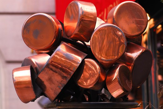 Stock Photo: 4183R-4328 Bunch of old shiny copper pots near a restaurant