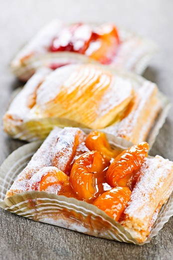 Closeup on slices of flaky fruit strudel desserts : Stock Photo